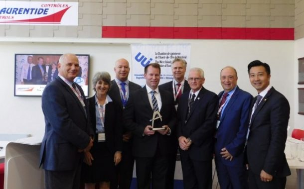 The WIMCC Officially Presents Laurentide Controls with Business of the Year Trophy
