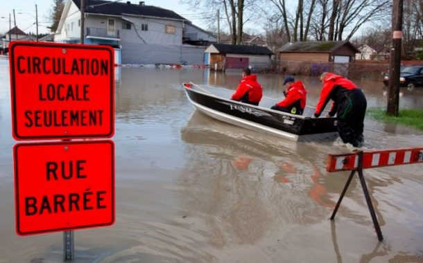 Over 200 volunteers lend a helping hand to flood victims during Big Clean-up Operation in Pierrefonds