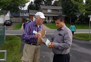 Marcel Roux explains the Neighbourhood Watch program to a Beaconsfield parent