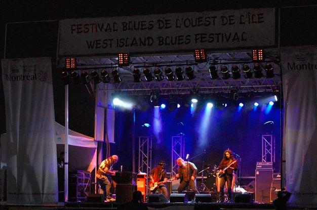 Image Source: https://www.westislandbluesfestival.com/photos?lightbox=i81s89