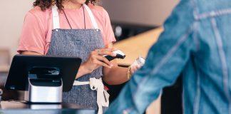 employee worker Cashier retail store clerk scanning cash spending money