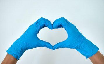 flu-shot-west-island-blue-latex-gloved-hands-making-the-shape-of-a-heart-anton-8q-U8X1zkvI-unsplash